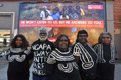 Pic by Dominic O'Brien. Traditional owners from Muckaty, near Tennant Creek, NT come to Melbourne for legal meetings about their federal court case against a nuclear waste dump on their country. L to R Posing infront of a billboard in Northcote are Gladys Brown, Mark Lane, Jeannie Sambo, Dianne Stokes and Doris Kelly.