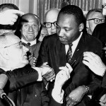 Martin Luther King, Jr. and Lyndon Johnson as the Civil Rights Act is signed